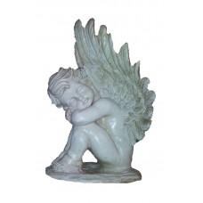 Ангел на камне смотрит влево